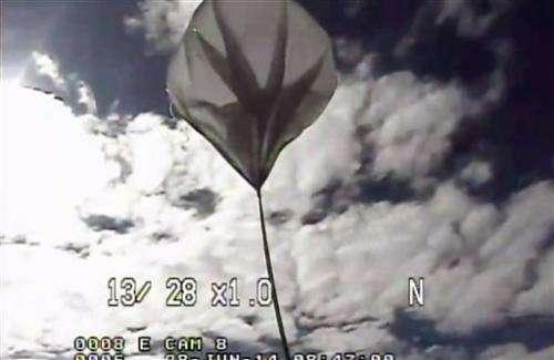 Mars 'flying saucer' splashes back down after test
