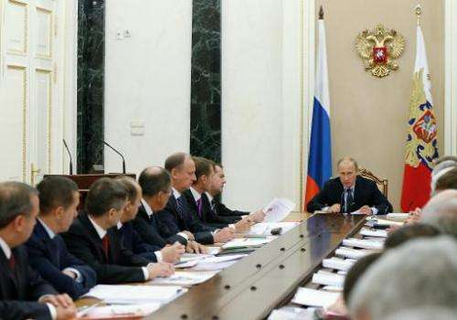 Russian President Vladimir Putin chairs a Security Council meeting at the Kremlin in Moscow on October 1, 2014