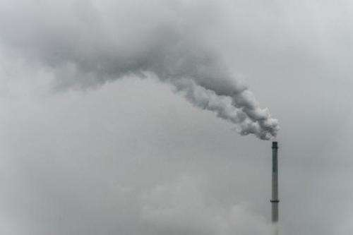 Smoke rises from the chimney of a factory in Plattling, southern Germany, on October 9, 2012
