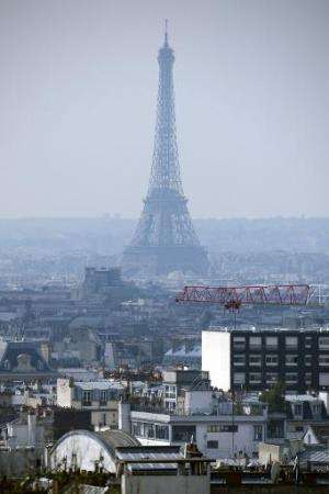 The Eiffel Tower surrounded by smog in Paris on March 27, 2014