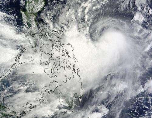 NASA satellite sees Typhoon Matmo brush eastern Philippines