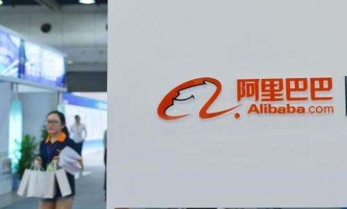 A woman walks past the Alibaba booth at an exhibition in Hangzhou, eastern China's Zhejiang province on September 9, 2014