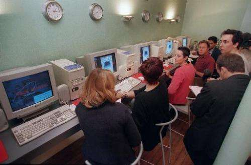 """File picture shows customers at the """"Café orbital"""" in Paris in 1995, the first Internet cafe in France to give its cus"""