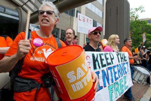 """Protesters hold a rally to support """"net neutrality"""" and urge the Federal Communications Commission (FCC) to reject a p"""