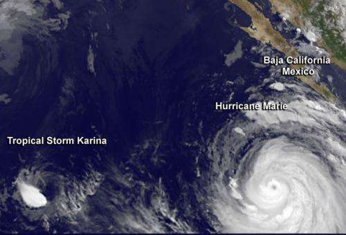 NASA sees Tropical Storm Karina overpowered by Hurricane Marie