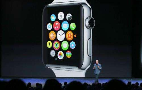 Apple CEO Tim Cook talks about the Apple Watch during a special event at the Flint Center for the Performing Arts on September 9