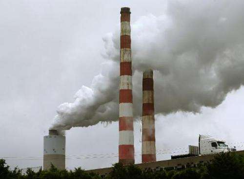 Emissions spew out of a large stack at a coal fired electric generating plant, on May 29, 2014 in Newburg, Maryland