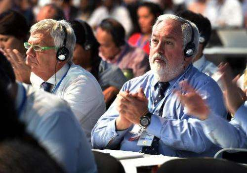 EU Commissioner for Energy and Climate Action, Miguel Arias Canete, applauds during the seventh plenary meeting of the COP20 on