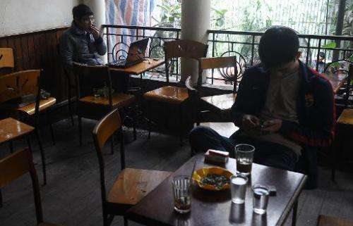 File picture shows customers online at a coffee shop in downtown Hanoi