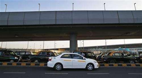Uber meets local lookalikes in Asia taxi-app wars