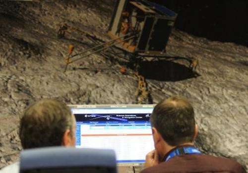 Scientists monitor the trajectory and data transmitted by the robot Philae aboard the European Space Agency's (ESA) comet-chasin