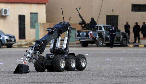A bomb disposal robot takes part in a police graduation ceremony at a police academy in Tripoli, Libya, on January 1, 2013