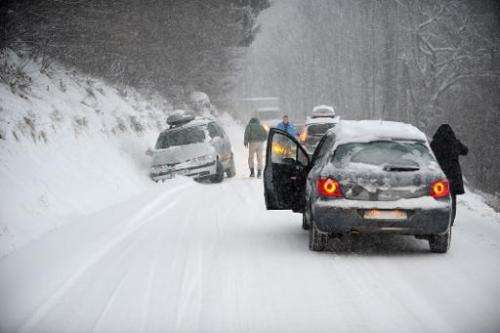 A car is stuck in the snow on December 27, 2014 on the road to Les Saisies ski resort in Savoie, central-eastern France