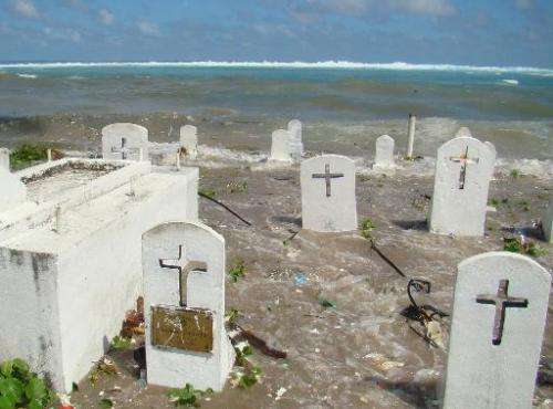 A cemetery on the shoreline of Majuro Atoll in the Marshall Islands is flooded during high tide, December, 2008