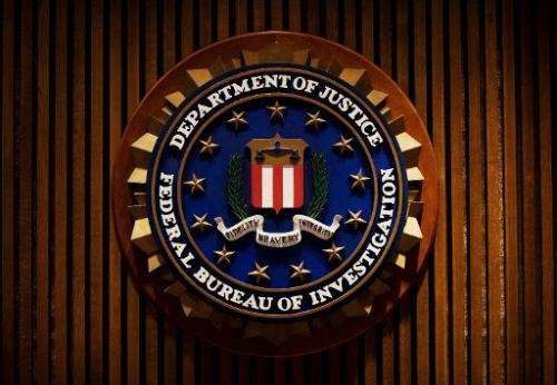 A crest of the Federal Bureau of Investigation is seen August 3, 2007 inside the J. Edgar Hoover FBI Building in Washington, DC