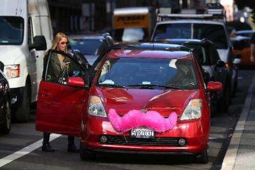 A customer gets into a Lyft car in San Francisco, California on January 21, 2014