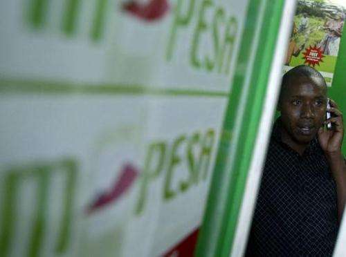 A customer talks on his mobile phone at an M-pesa shop in Nairobi, on April 23, 2007