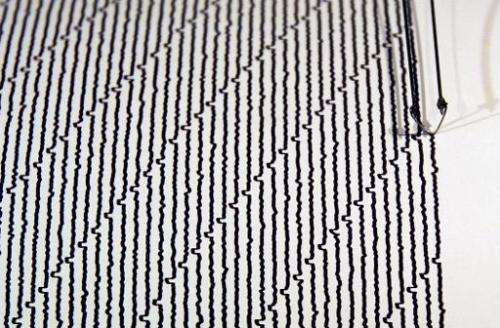 A drum seismograph records the shaking of the ground on June 23, 2004 at the Museum of Natural History in New York City