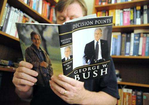 A man reads a memoir by former US President George W. Bush in this November 9, 2010 at his home in Manassas, Virginia