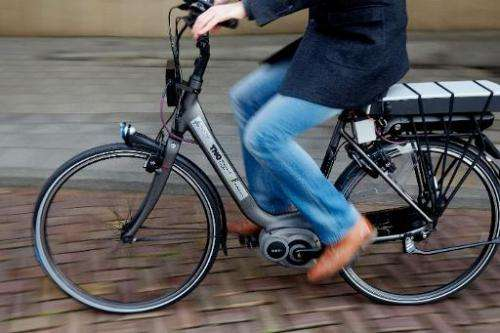 A man tests a bike with special safety technology in The Hague, on December 15, 2014