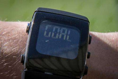 A man tests a special watch to be used as part of goalline technology for the World Cup is pictured at Maracana Stadium in Rio d