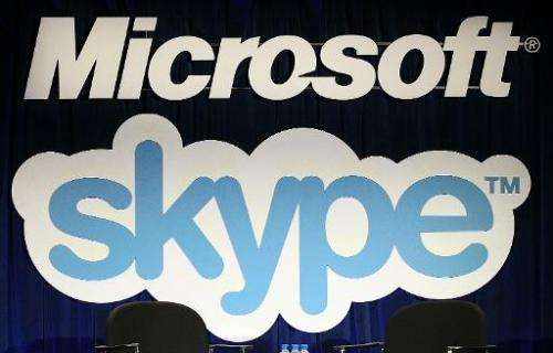 A Microsoft and Skype sign hangs on stage at a news conference about the purchase of Skype on May 10, 2011 in San Francisco, Cal