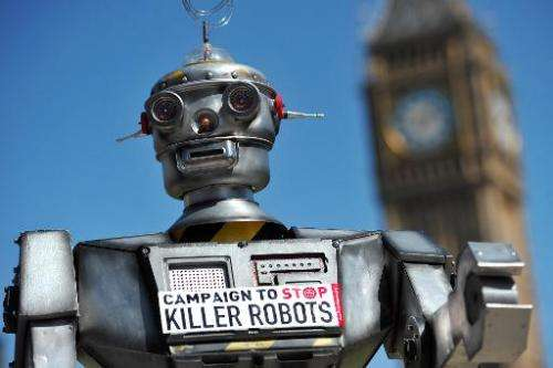 "A mock ""killer robot"" is pictured in central London on April 23, 2013 during the launching of against lethal robot wea"