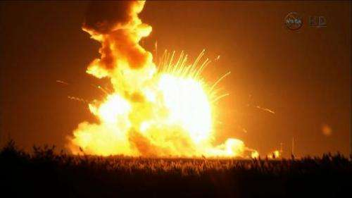 A NASA video image shows an Orbital Sciences Corporation unmanned spacecraft exploding on October 28, 2014 at Wallops Island, Vi