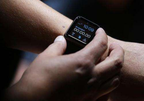 An attendee inspects the new Apple Watch during a special event at the Flint Center for the Performing Arts on September 9, 2014