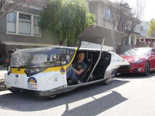Andre Snoeck, operations manager for Solar Team Eindhoven, prepares to drive off in solar-powered family car 'Stella' in San Fra