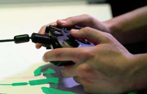An Xbox One controller is used at the Los Angeles Convention Center on June 11, 2013