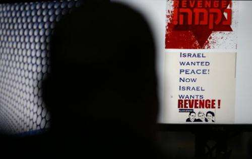 A person in Jerusalem on July 3, 2014 browses an Israeli social network website inciting attacks against Palestinians