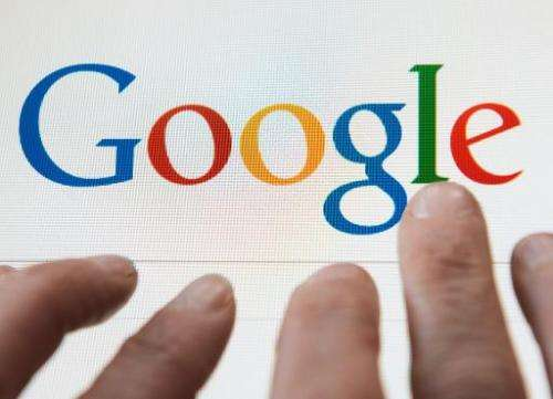 A person prepares to search the Internet using the Google search engine, on May 14, 2014, in Lille