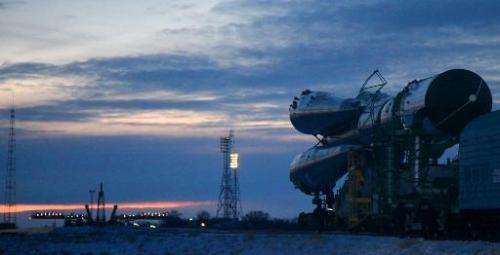 A Russian Soyuz-U booster carrying an unmanned cargo spacecraft Progress M-22M is transported to a launch pad at the Russian lea
