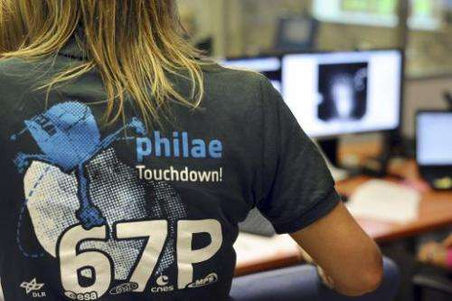 A scientist wears a t-shirt depicting the European Space Agency's robot craft Philae, in the scientific mission observation cent