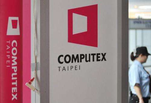 A security officer walks past a billboard featuring Computex, Asia's leading IT trade fair, in Taipei on June 1, 2014