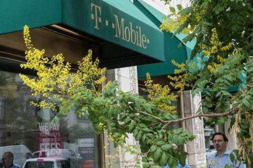 A T-Mobile shop is seen in Washington, DC, on August 1, 2014