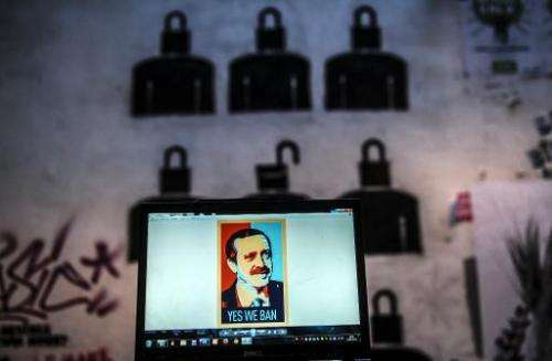 """A view of a computer screen showing a digital portrait of the Turkish Prime Minister and text reading """"Yes we ban"""" on"""