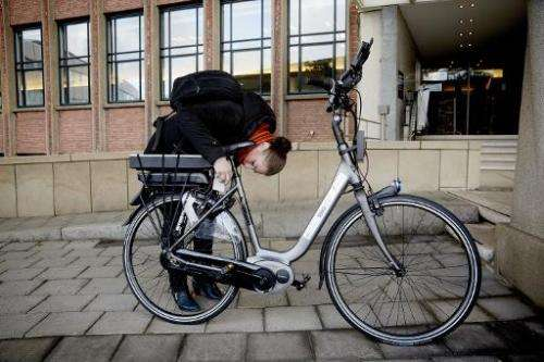 """A woman tests an """"intelligent"""" bike with special safety technology in The Hague, Netherlands, on December 15, 2014"""
