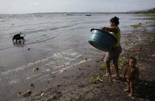 A woman walks into the water to do her laundery in Lake Nicaragua, on April 24, 2014