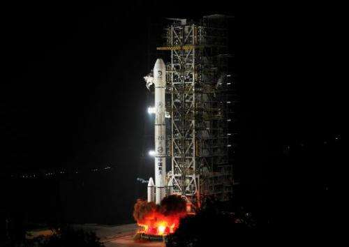 China's Chang'e-3 rocket, carrying the Jade Rabbit rover, blasts off from the Xichang Satellite Launch Center in Sichuan on Dece