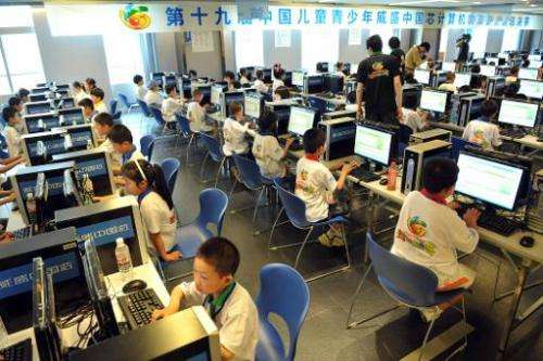 Chinese children attend a computer class in Beijing to learn how to use the Internet
