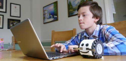 Computer programming with a robot that is a toy at heart