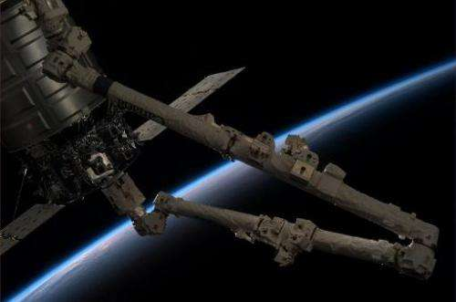 Crew members aboard the International Space Station release Orbital Sciences' Cygnus spacecraft from the station's robotic arm,