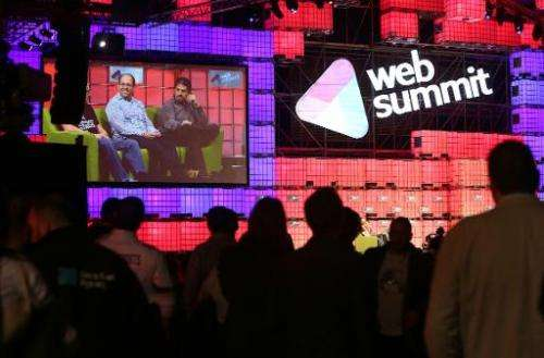 Delegates attend one of the many live talks at the Web Summit in Dublin, Ireland, on November 6, 2014