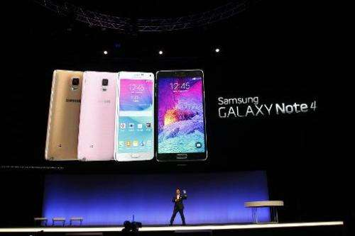 Executive Vice President of electronics giant Samsung D J Lee presents a new version of the company's giant-sized smartphone, th