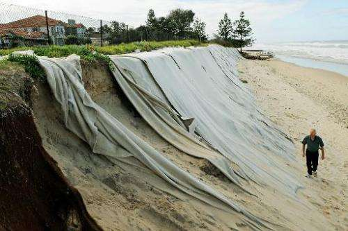 Felt sheeting draped over sandhills to help slow the progress of erosion is seen in front of the Meridien holiday apartments in