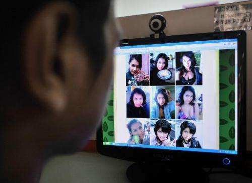 File photo of a man browsing pictures of Japanese porn idols posted on a local website at a public Internet service in Jakarta o