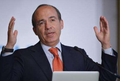 Former Mexican president Felipe Calderon delivers the keynote address during the 18th annual CAF, Development Bank of Latin Amer