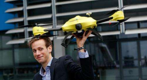 Graduated TU Delft student Alec Momont shows his design of an ambulance drone with a built in defibrillator in Delft, Netherland